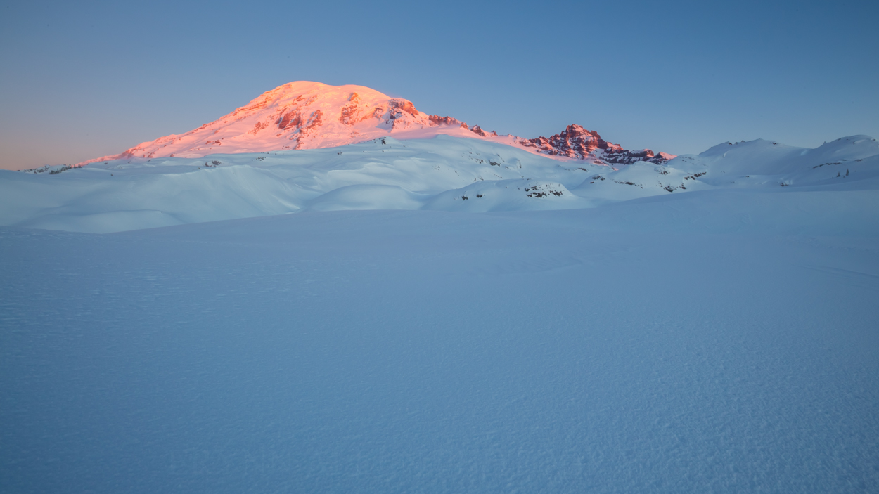 Rainier's summit is first to feel the warm daylight.