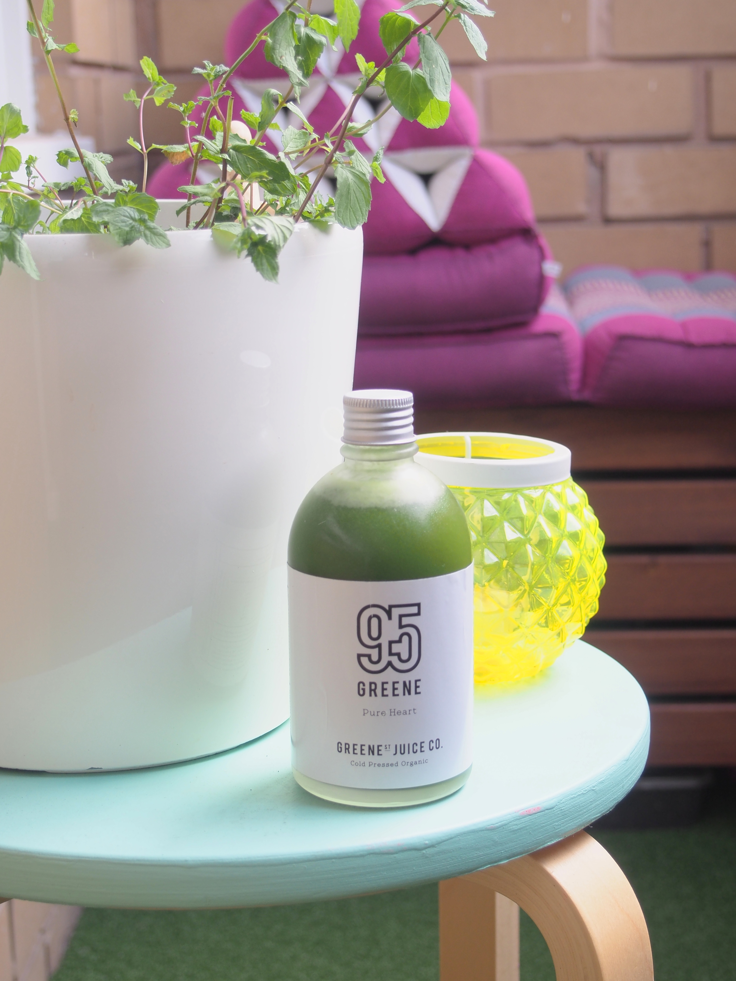A green juice combining celery, cucumber, kale, green apple, ginger mint and parsley.