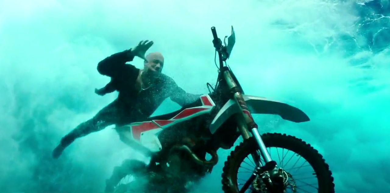 Yeah... this actually happens. They ride   motorcycles  through a wave. Sigh.