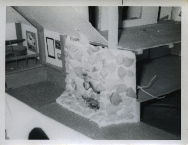 Here Brad builds a model of his dream studio with fireplace and grand piano in it at the age of 13.