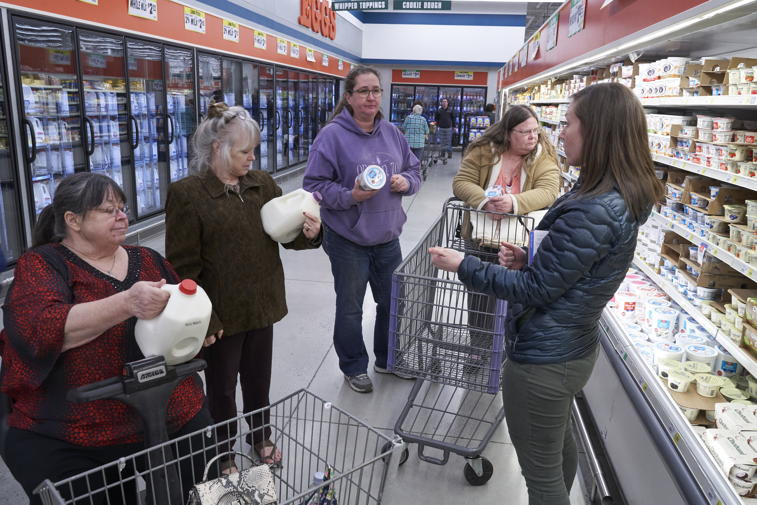 Clients are taught how to carefully examine and compare food labels and nutrition facts during the Cooking Matters Grocery Store Tour.