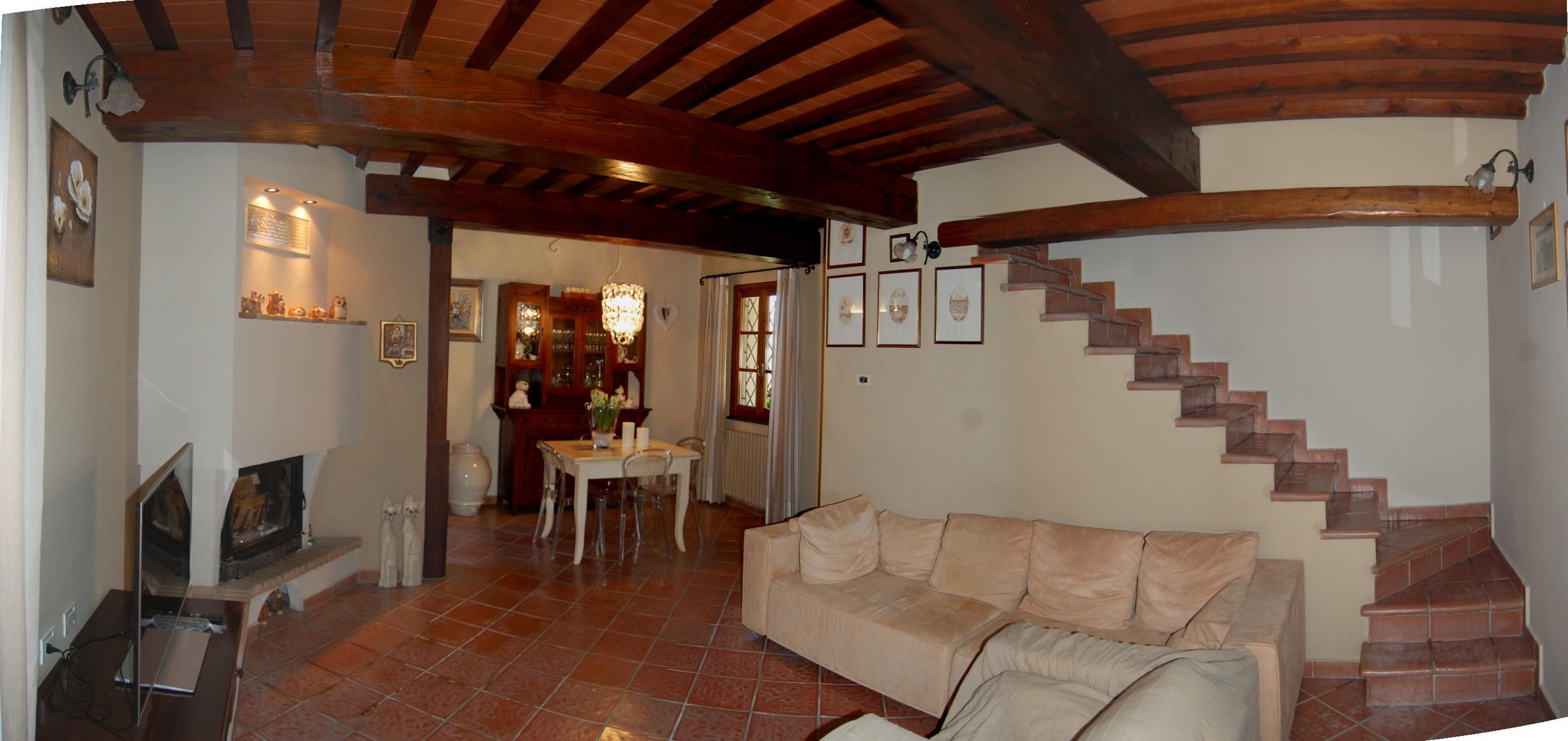 08A-Vista del soggiorno dall'ingresso.jpg