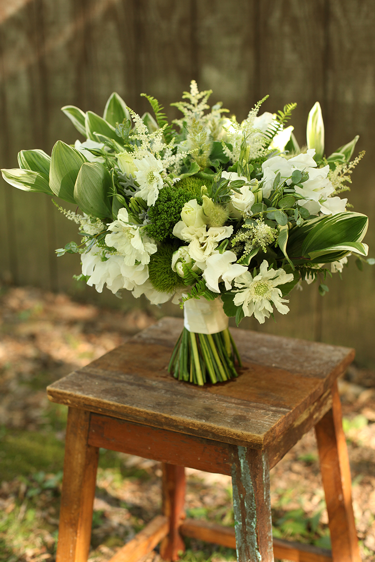 Bridal bouquet with white scabiosa, sweet pea, astilbe, lisianthus, tulips, polygonatum, bunny grass, green dianthus, fern, trachelium, eucalyptus and dusty miller. By Cincinnati florist Floral Verde.