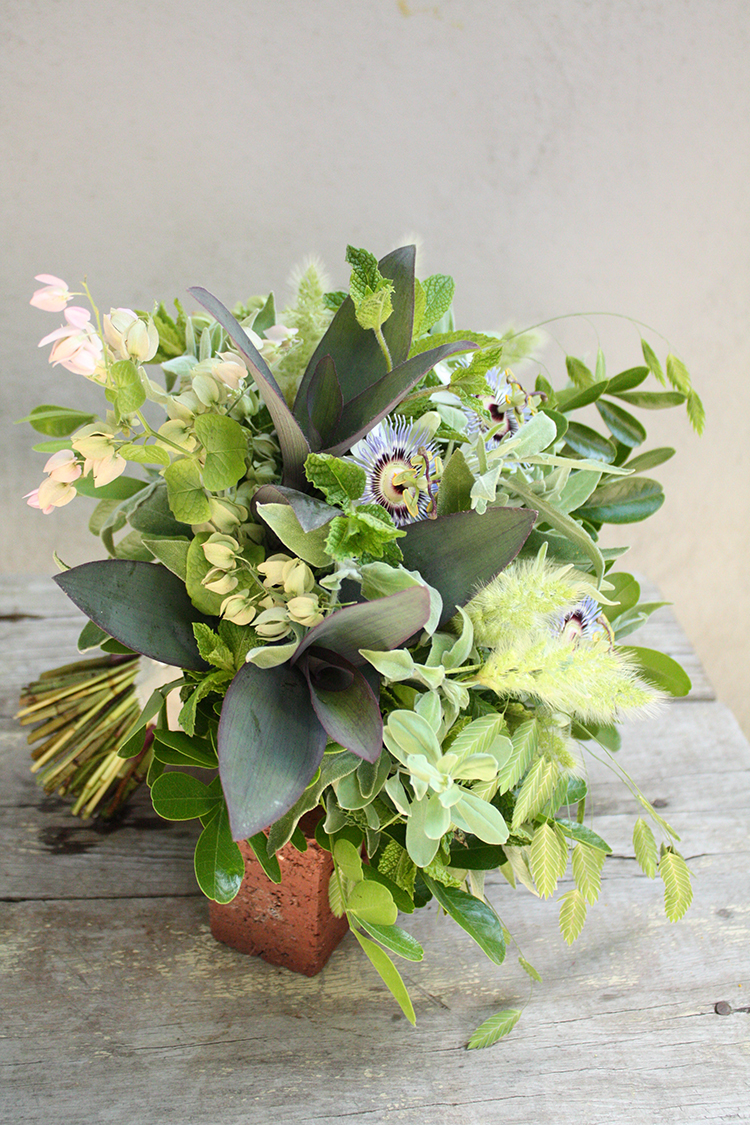 Foraged bouquet with passion flowers, coral vine, bunny grass, northern sea oats, mint, sage, Purple Heart Wandering Jew, and Mountain Laurel. By Cincinnati wedding florist Floral Verde LLC.