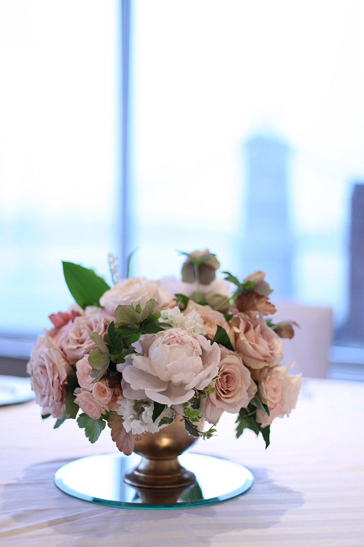 Blush centerpiece in the RiverView Ballroom at the Cincinnati Marriott RiverCenter, with peonies, lily of the valley, roses, garden roses, hellebores and stock, by florist Floral Verde.