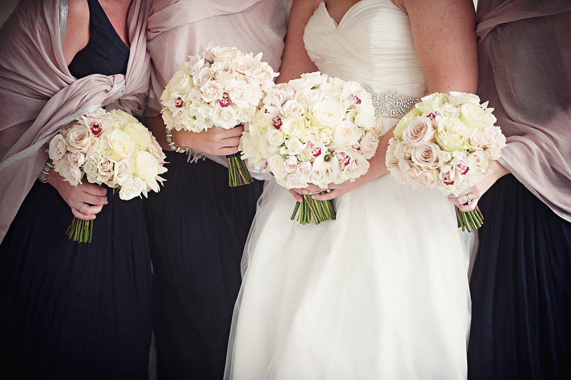 Bouquets with white hydrangea, white mini callas, Snow Flake spray roses, white mini cymbidium orchids, Mondial roses, White O'Hara garden roses, Porcelina spray roses and White Majolica spray roses. Flowers by Cincinnati wedding florist Floral Verde LLC. Image by Leah Robbins Photography .