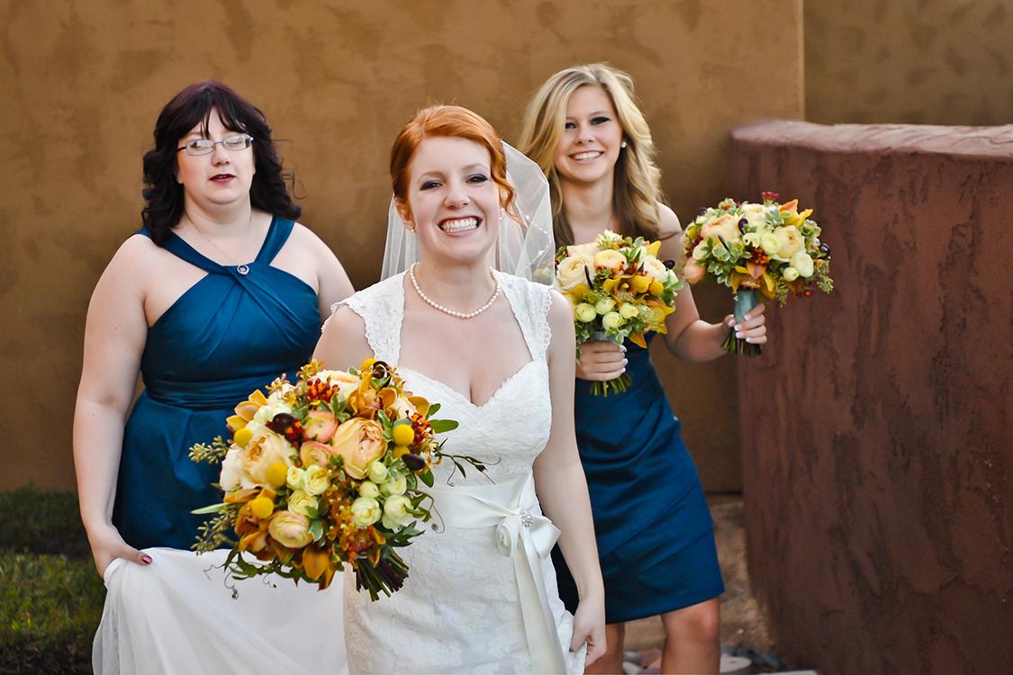 Bridal bouquet with fern curls, chocolate cymbidium orchids, asclepias, peach ranunculus, Caramel Antike garden roses, Creamy Eden spray roses and craspedia. By Cincinnati wedding florist Floral Verde