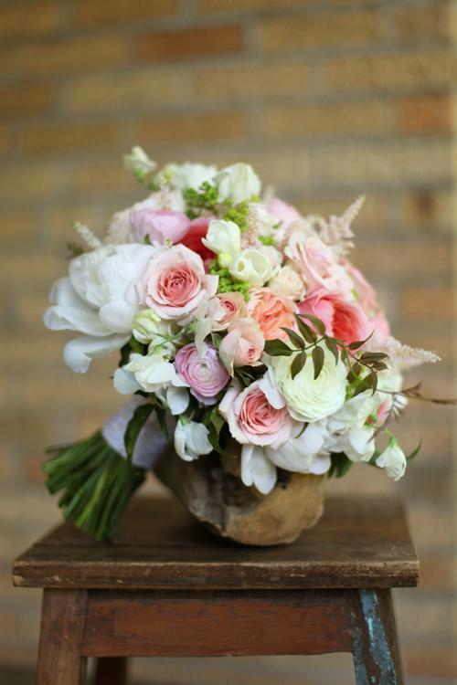 Bridal bouquet with Romantic Antike and Juliet garden roses, Star Blush spray roses, ranunculus, astilbe, peonies, freesia, sweet pea, alchemilla and jasmine vine. By Cincinnati florist Floral Verde.
