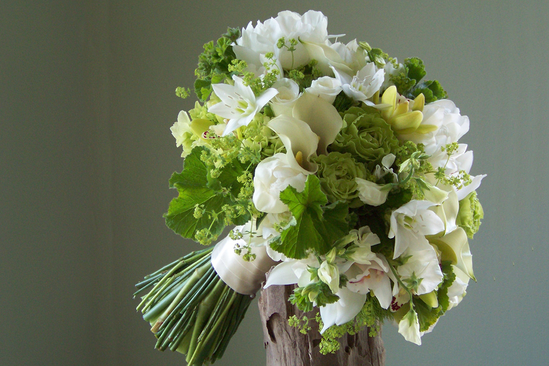 Bouquet with Eucharis lilies, white mini callas, peonies, sweet pea, mini cymbidiums, hydrangea, Super Green roses, Green Trick dianthus, alchemilla and scented geranium. By Floral Verde in Cincinnati