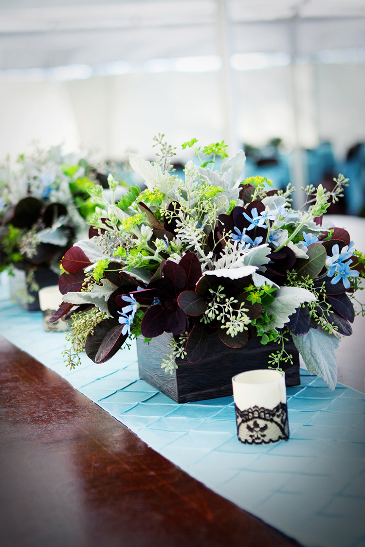 Foliage centerpiece by Cincinnati wedding florist Floral Verde LLC. Centerpiece contains cotinus, tweedia, dusty miller, seeded eucalyptus, and bupleurum in a wooden box. Image courtesy of  Silver Thumb Photography .