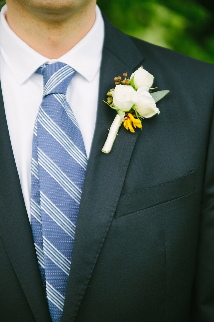 Boutonniere with White Majolica spray roses, yellow kangaroo paws and seeded eucalyptus. Flowers by Cincinnati wedding florist Floral Verde LLC.