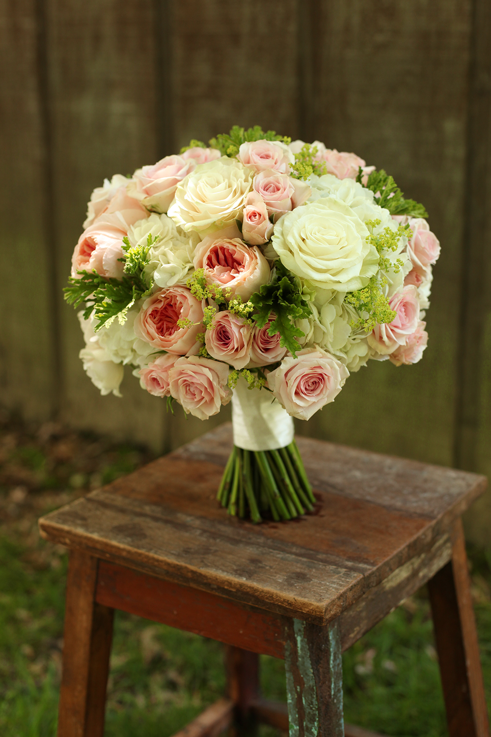 bridal bouquet by wedding florist Floral Verde LLC in Cincinnati, Ohio; with Star Blush spray roses, Juliet garden roses, White Majolica spray roses, Mondial roses, white hydrangea, alchemilla and lacy scented geranium