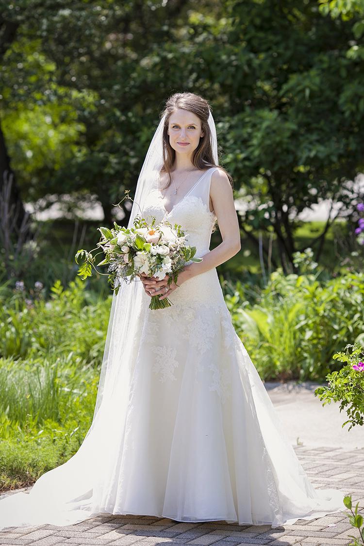 Bridal bouquet with Juliet garden roses, blush peonies, astilbe, freesia, sweet pea, Jasmine, polygonatum, scented geranium, eucalyptus and dusty miller. By Cincinnati wedding florist Floral Verde.