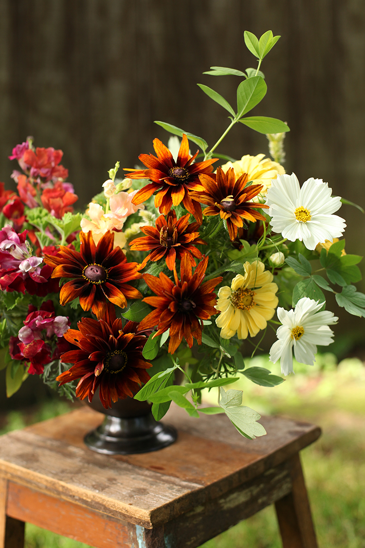 Locally sourced centerpiece with cosmos, zinnias, rudbeckia, snapdragons and geranium, by Cincinnati florist Floral Verde LLC.