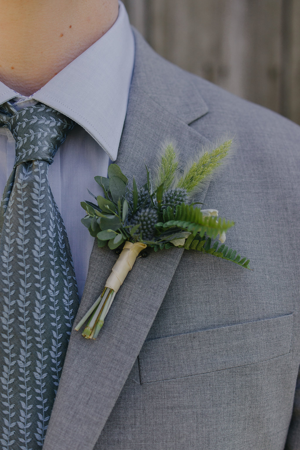 Boutonniere with eryngium, dusty miller, gunnii eucalyptus and bunny tail grass. By Cincinnati wedding florist Floral Verde.