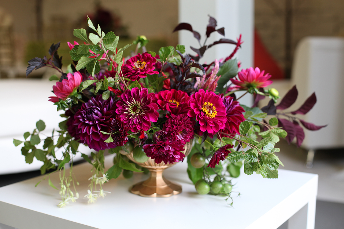 Locally sourced, jewel-toned centerpiece with dahlias, zinnias, cosmos and tomatoes, by Cincinnati wedding florist Floral Verde LLC.