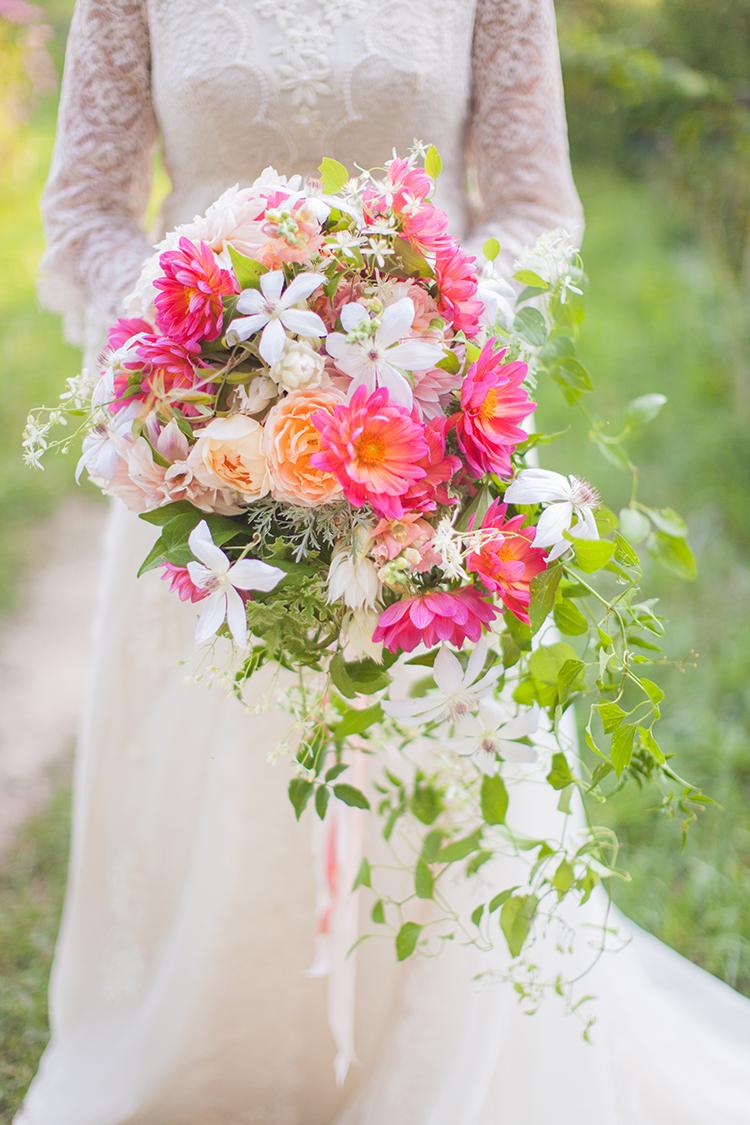 Cascading bridal bouquet with dahlias, garden roses and clematis. By Cincinnati wedding florist Floral Verde.