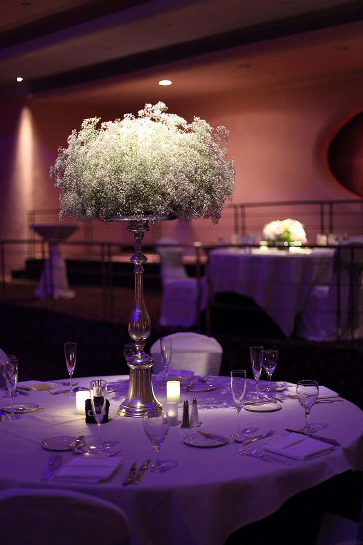Elevated baby's breath centerpiece in the Pavilliion Ballroom at the Hilton Netherland Plaza Hotel, by Cincinnati wedding florist Floral Verde LLC.