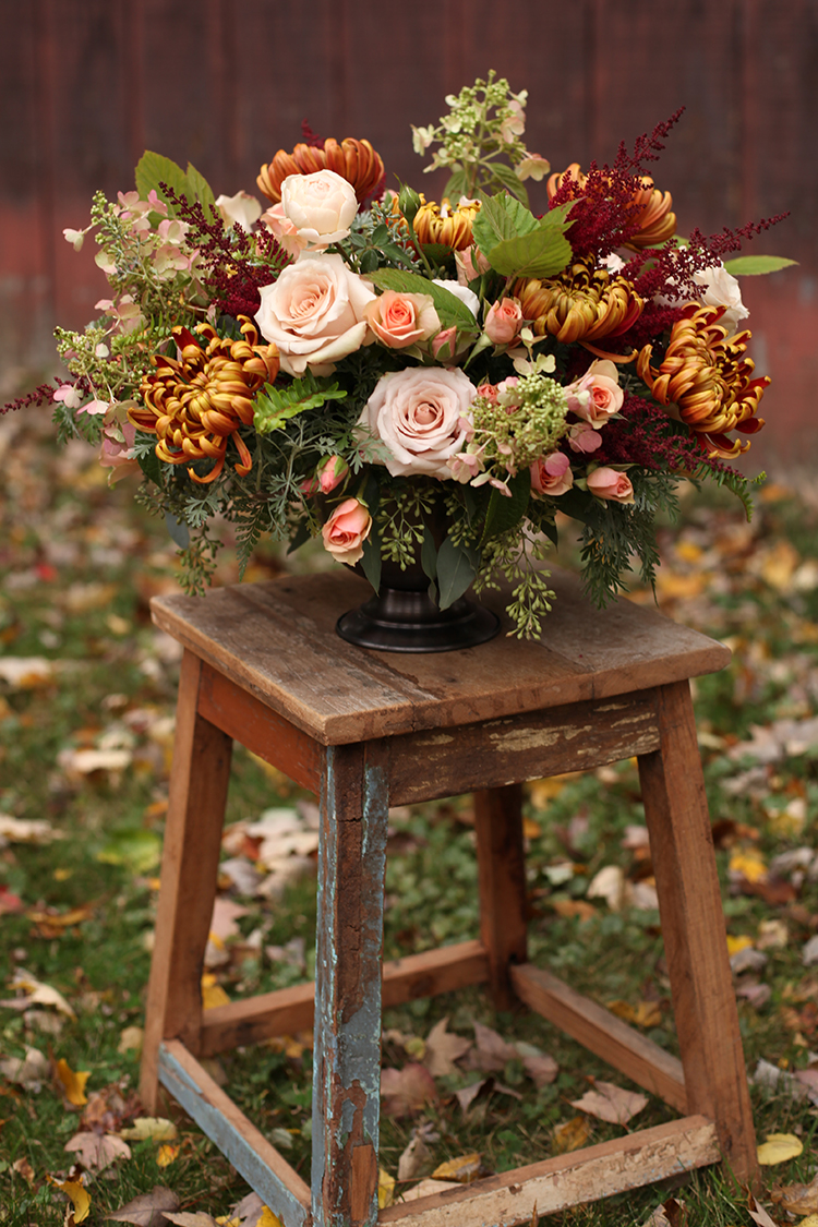 Autumn-hued centerpiece by Cincinnati wedding florist Floral Verde LLC.
