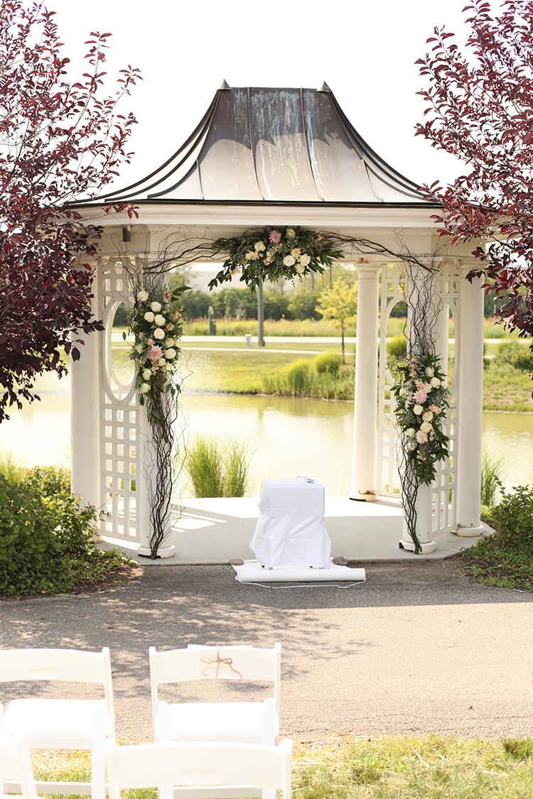 Wedding ceremony gazebo at Mulhauser Barn. Flowers by Cincinnati wedding florist Floral Verde.