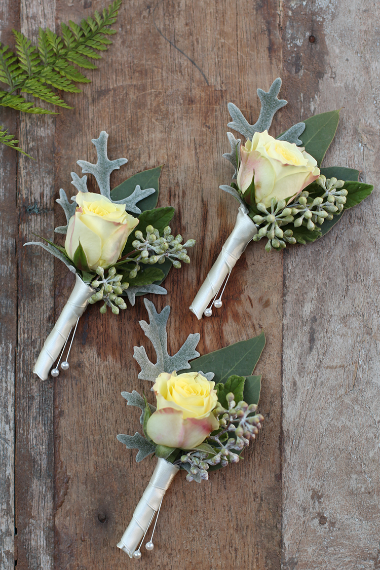 Yellow rose boutonnieres by Cincinnati wedding florist Floral Verde.