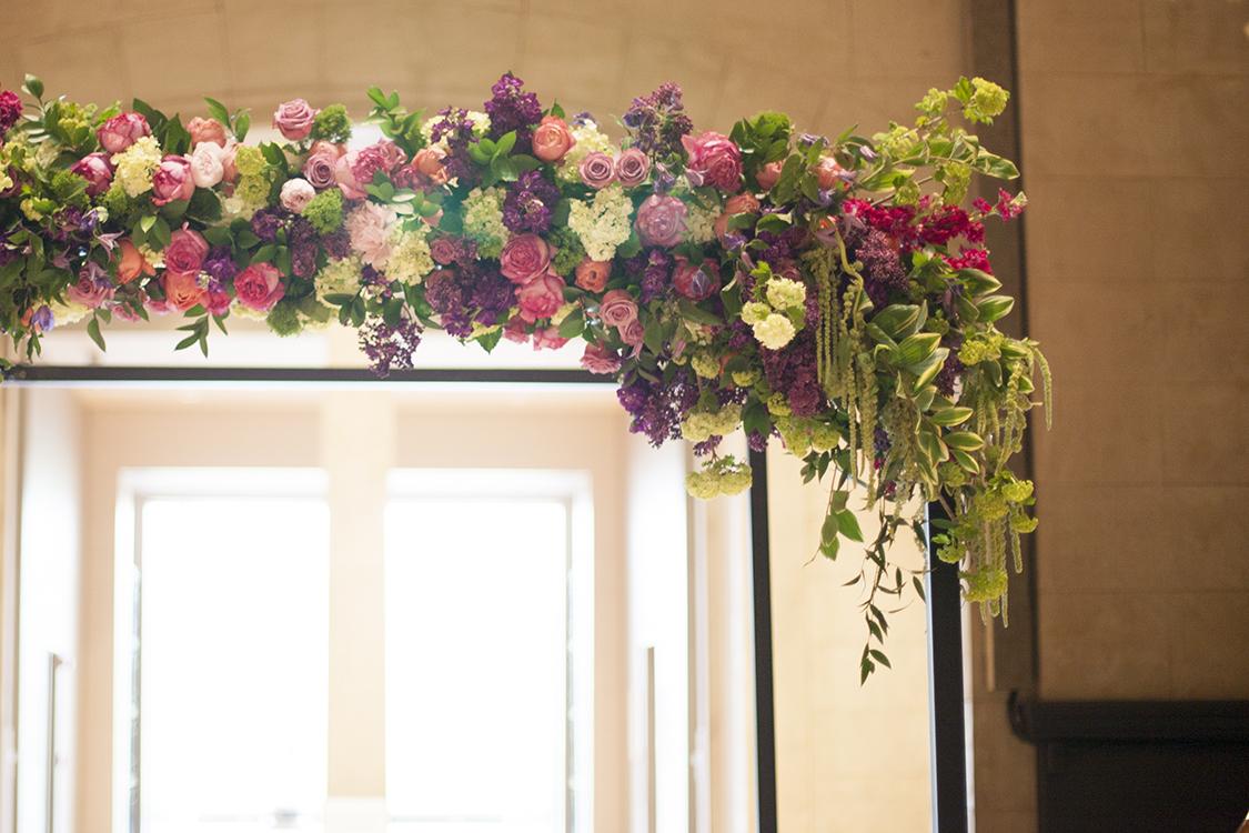 Wedding ceremony at the Cincinnati Art Museum. Flowers by Cincinnati wedding florist Floral Verde.