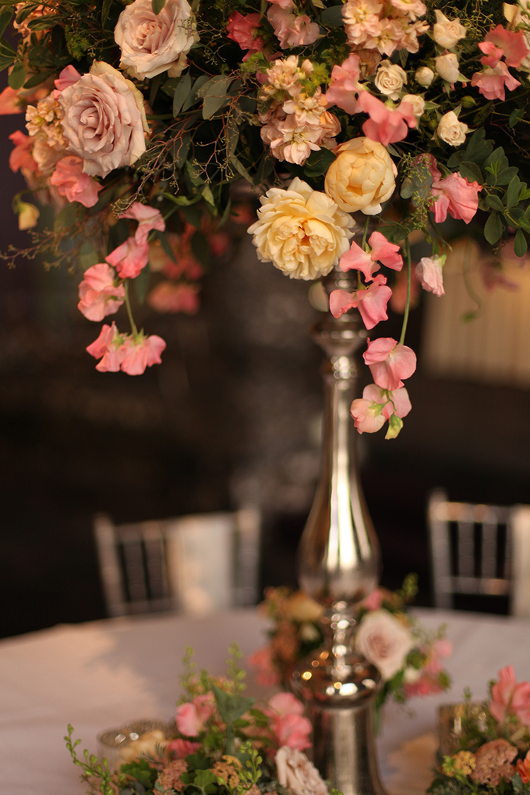 Elevated garden centerpiece in the Continental Room at the Hilton Netherland Plaza Hotel, by Cincinnati wedding florist Floral Verde.