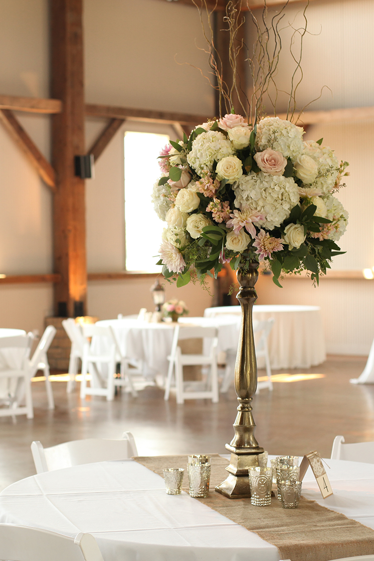 Tall white and blush centerpiece at Muhlhauser Barn, by Cincinnati wedding florist Floral Verde.
