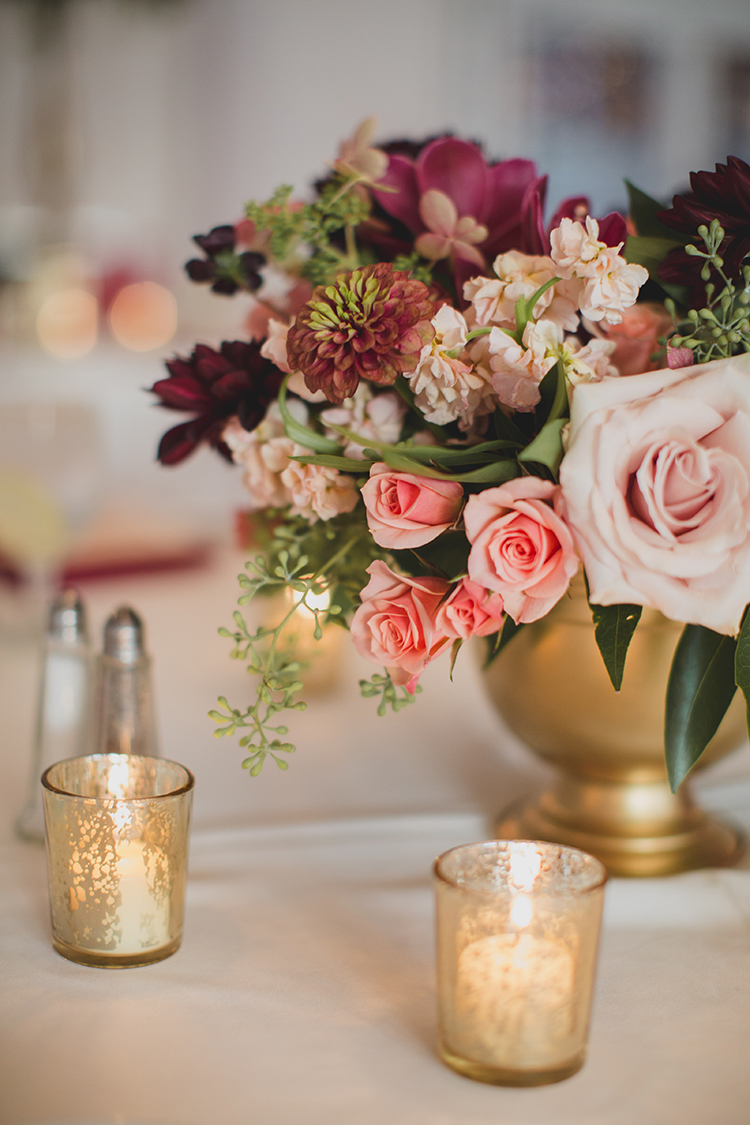 Centerpiece at wedding reception at Pinecroft Mansion, Cincinnati, Ohio. Flowers by Floral Verde LLC. Photo by Carly Short Photography.