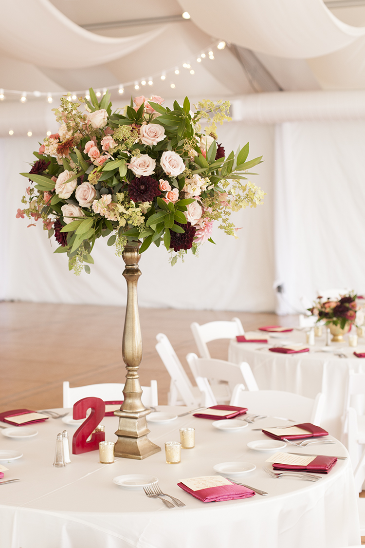 Tall centerpiece at wedding reception at Pinecroft Mansion, Cincinnati, Ohio. Flowers by Floral Verde LLC. Photo by Carly Short Photography.
