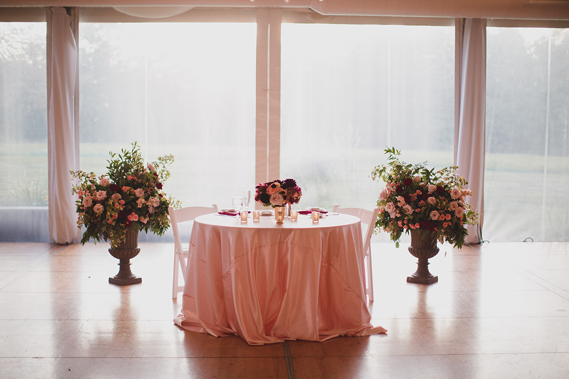 Altar arrangements repurposed to sweet heart table at wedding reception at Pinecroft Mansion, Cincinnati, Ohio. Flowers by Floral Verde LLC. Photo by Carly Short Photography.