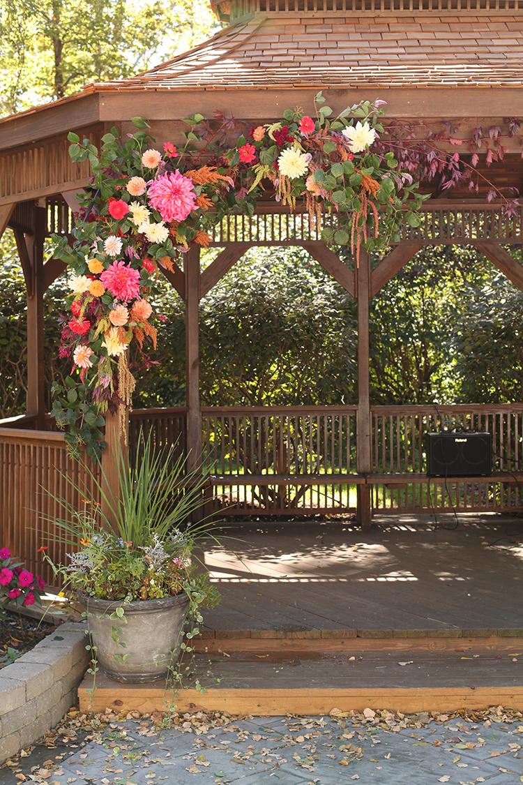 Wedding ceremony at Pattison Lodge gazebo. Flowers by Cincinnati wedding florist Floral Verde.