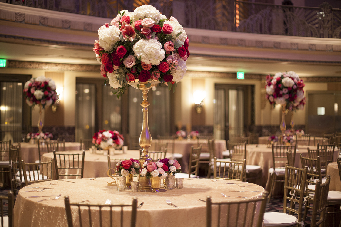 Wedding Reception in the Hall of Mirrors at the Hilton Netherland Plaza Hotel in Cincinnati, Ohio. Flowers by Floral Verde.