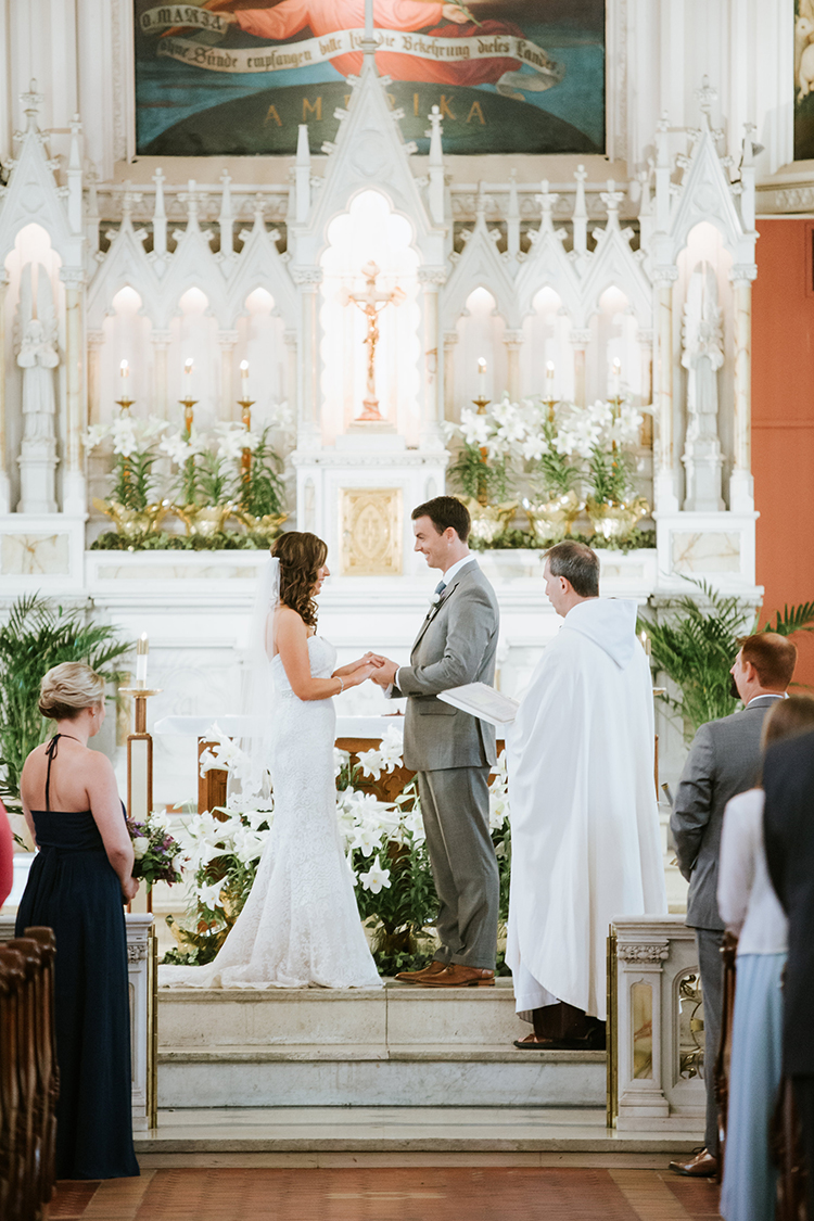 Wedding Ceremony at Holy Cross Immaculata in Cincinnati, Ohio. Flowers by Floral Verde. Photo by Eleven:11 Photography.