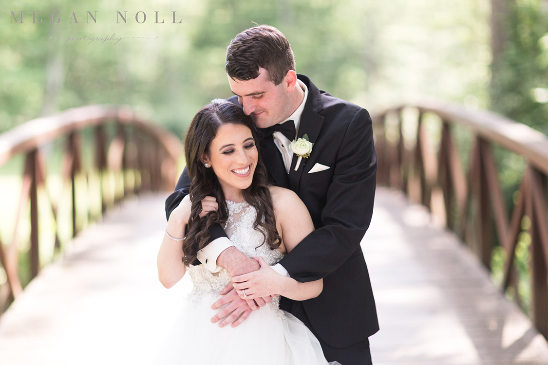 Wedding Ceremony at Aston Oaks Golf Club in North Bend, Ohio. Flowers by Floral Verde. Photo by Megan Noll Photography.