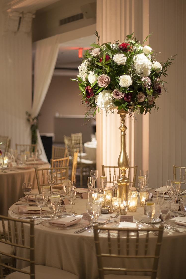 Tall white, blush and burgundy centerpiece at The Renaissance Cincinnati Hotel, by Cincinnati wedding florist Floral Verde.