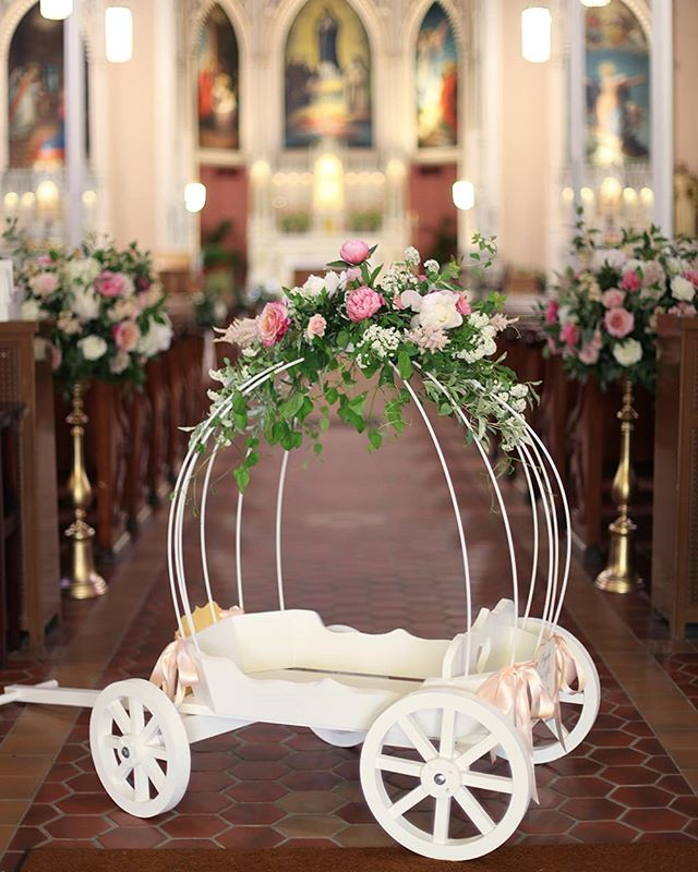 We also decorated a larger carriage for the ceremony at @hci_parish. I bet the flower girl looked darling riding down the aisle in this!