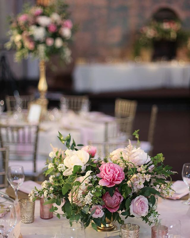 Lush, garden centerpieces from Rian and Mike's wedding at the @monasteryeventcenter.