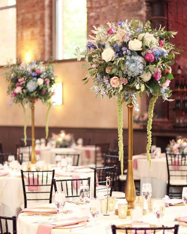 Kaitlin and Ben's ceremony arrangements were repurposed to the tables for the reception.