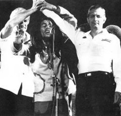 "Bob Marley unites the leaders of two fiercely opposing political parties in Jamaica at the ""One Love Peace Concert"" only days after being shot from an assassination attempt. The concert was in held in front of 32,000 Jamaicans in Kingston as an effort to bring peace during the political turmoil."