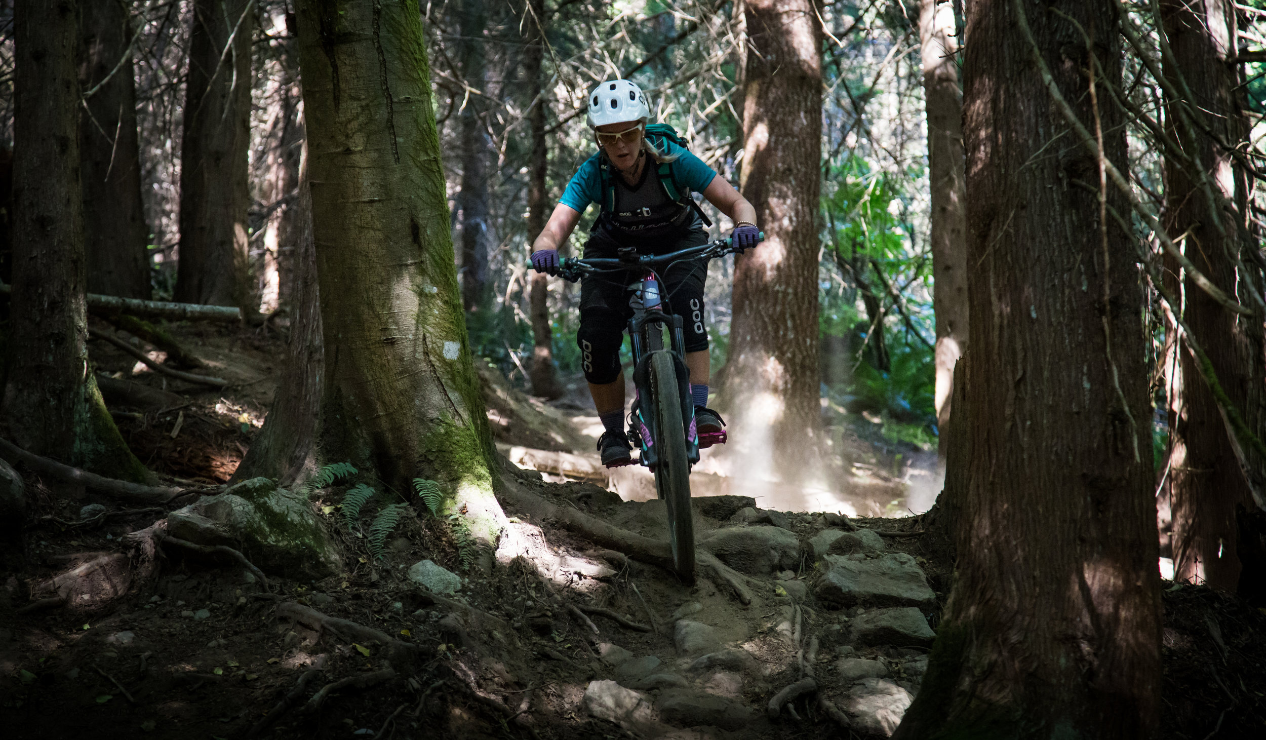 Navigating steep, rocky and rooty terrain is made to look easy by this girl...