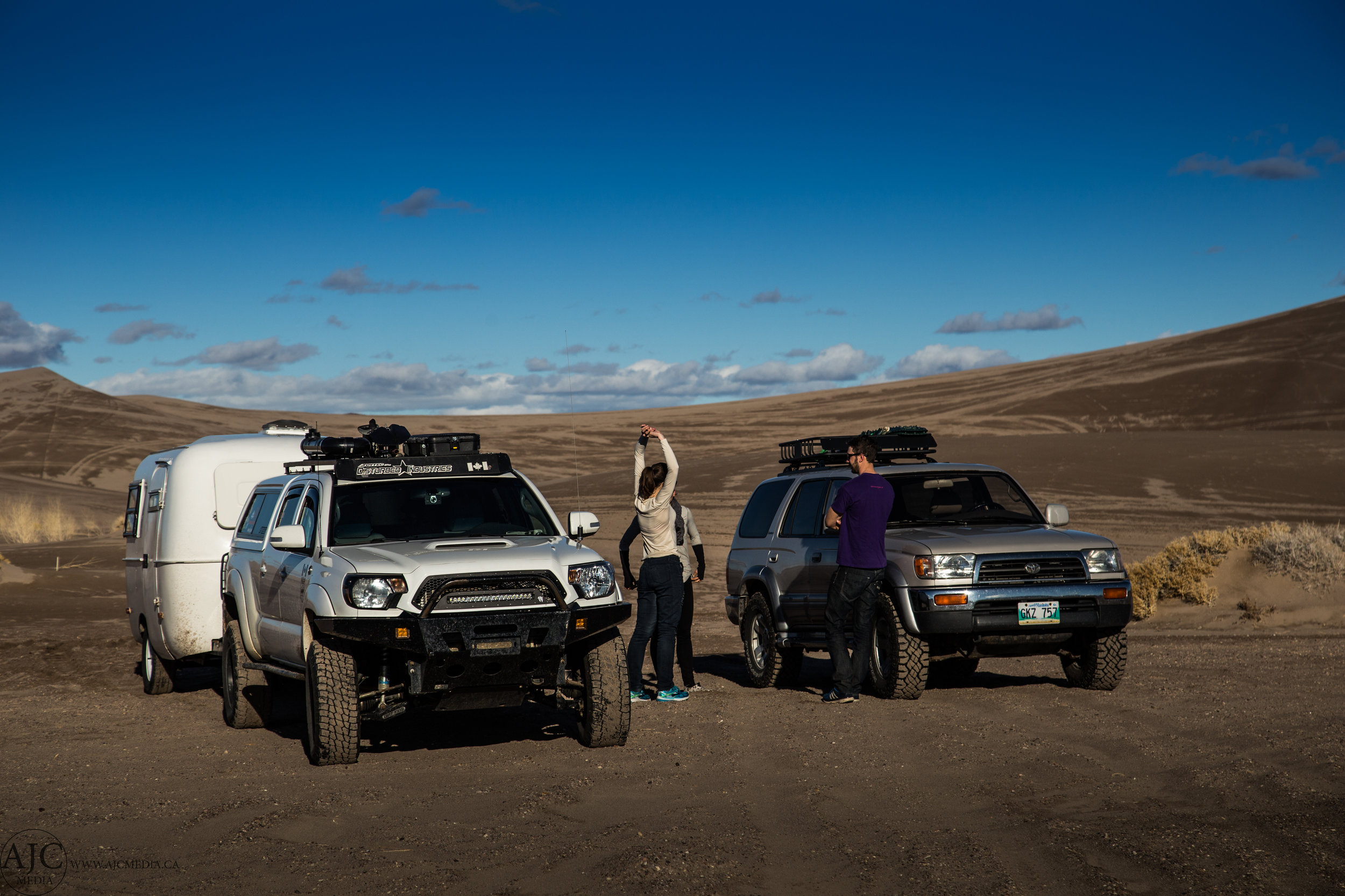 The trucks parked at the dunes. Shortly before we were both nearly stuck.