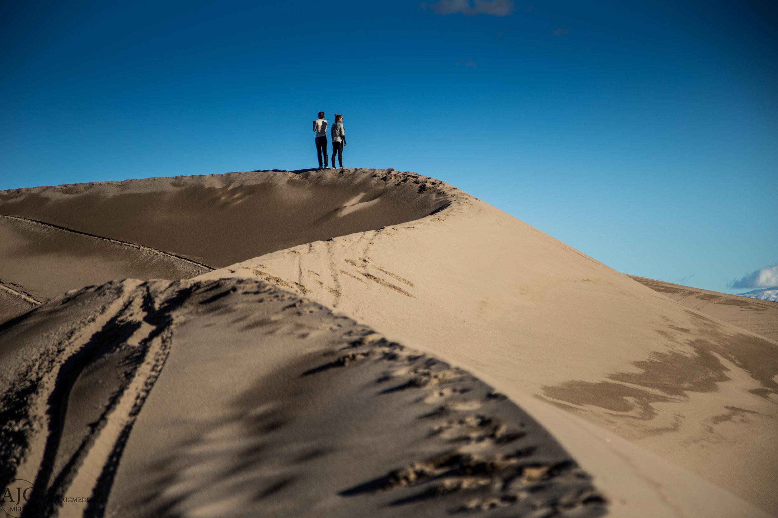 The girls climbing the dunes.