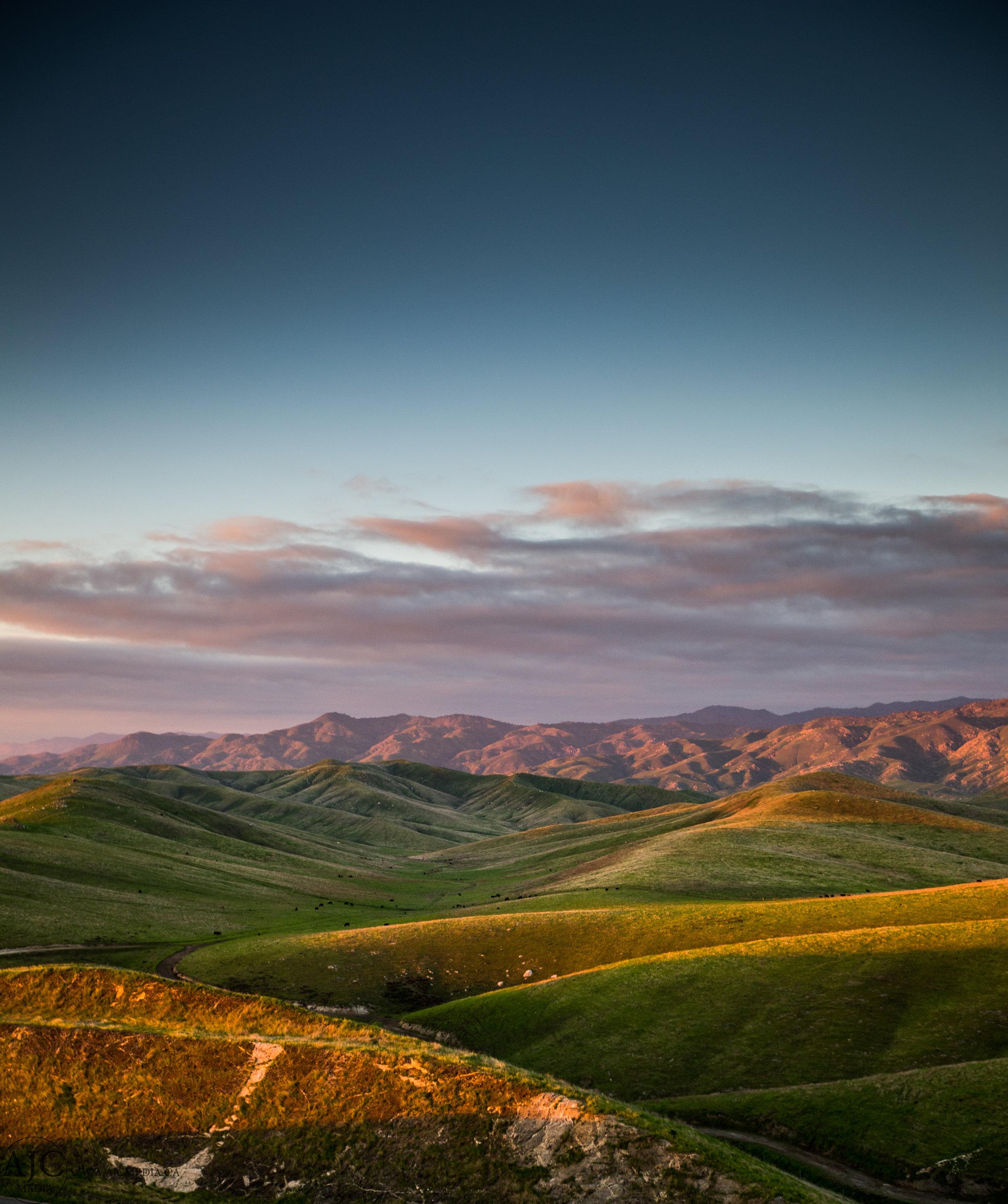 Rolling California foothills precede the Sierra's.