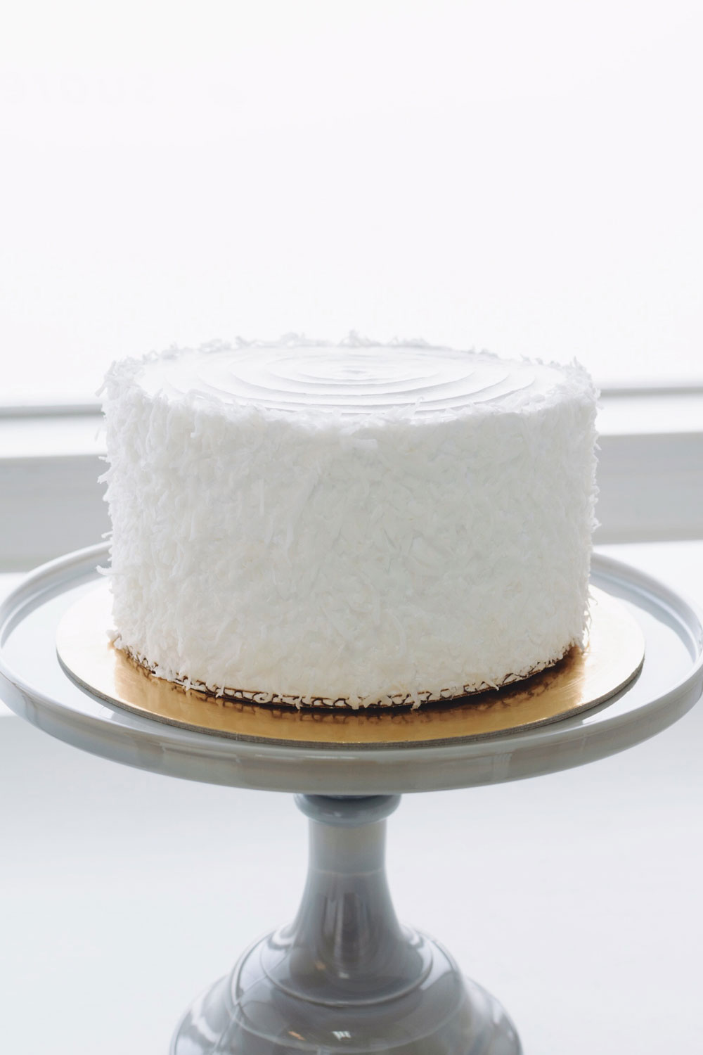 Coconut Cream - vanilla cake | coconut cream filling | whipped cream icing, shredded coconut