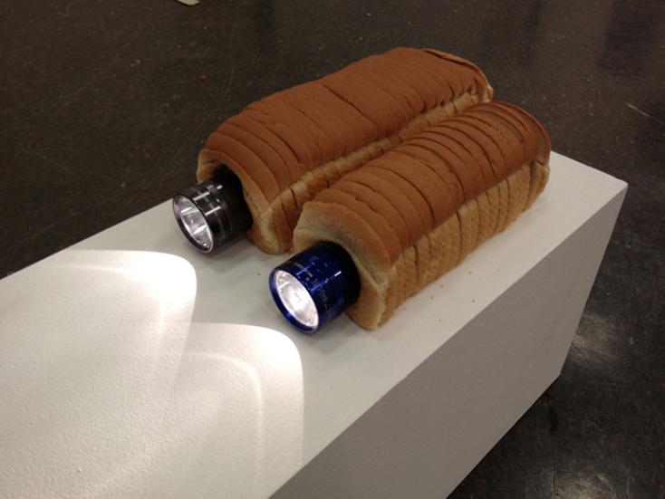 "David Lukowski. ""Do Something Boring."" Maglite flashlights and white bread."