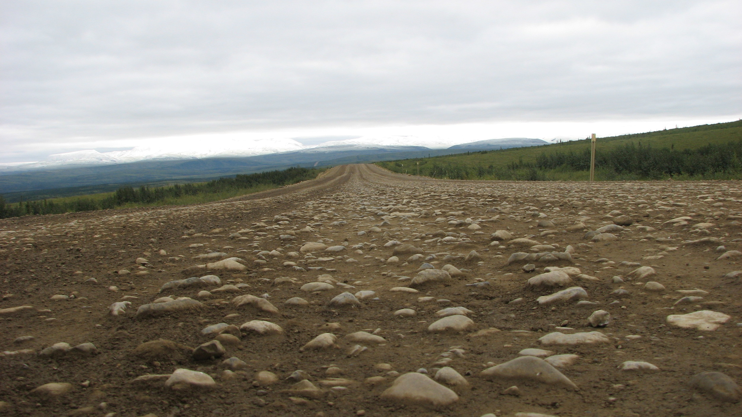 Look! There is some road on those stones.