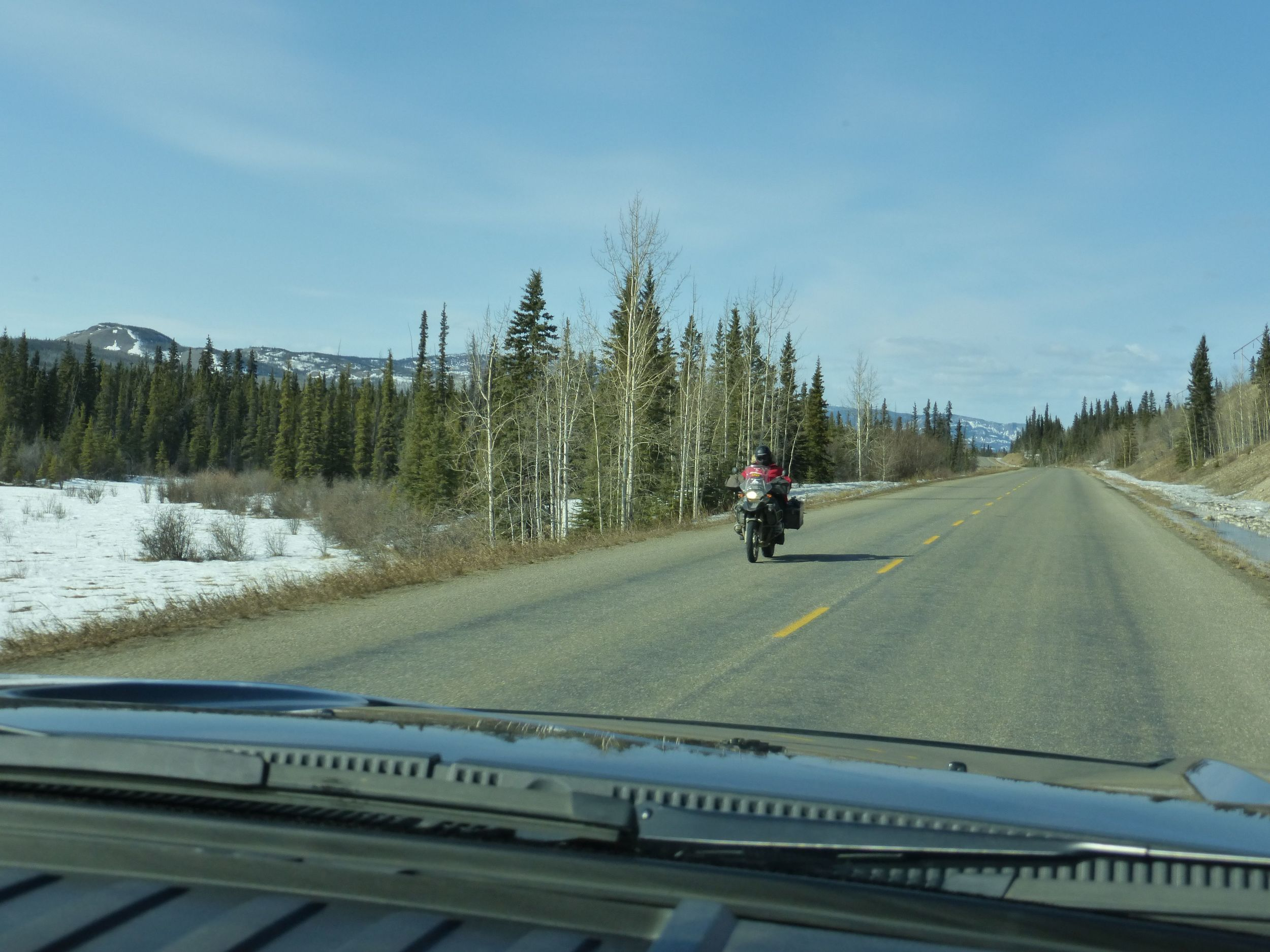 There is a temporary winter road connecting Old Crow, Yukon which is only accessible by air. This biker tried to get there but got turned back after 100km, wonder if I can make it? Would the road still be open?