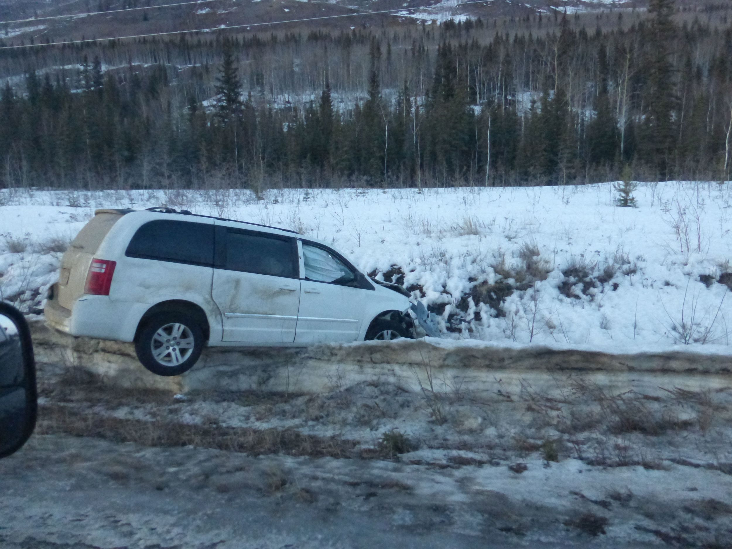 This is number 9, The Klondike Highway ditch was littered with cars who must have spun out of control because of a freezing rain they had recently.