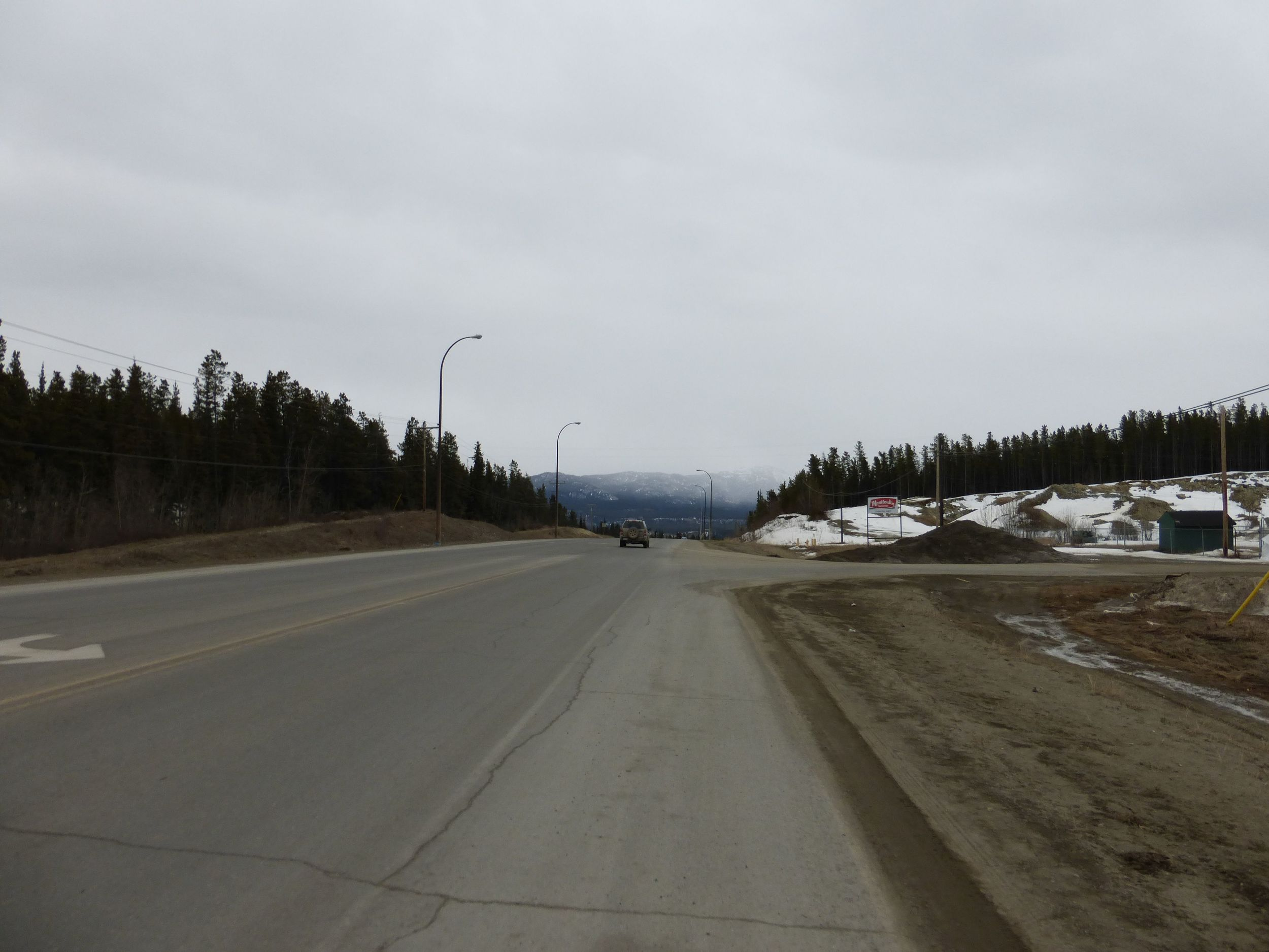 I am not in the picture but I was riding dirty into Whitehorse. Dirty and muddy.